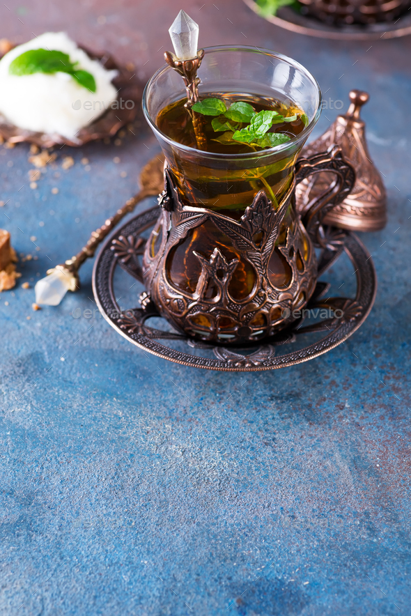 Bowl with Turkish cotton candy Pismaniye and black tea with mint on a dark background - Stock Photo - Images