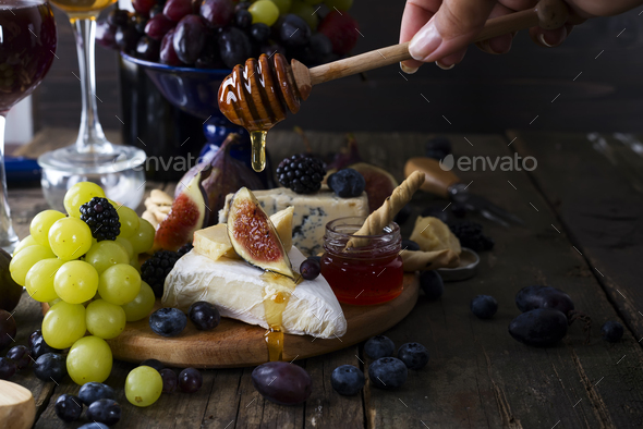 White wine, grape, bread, honey and cheese - Stock Photo - Images