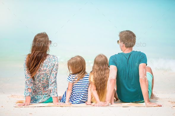 Photo of happy family having fun on the beach. Summer Lifestyle - Stock Photo - Images
