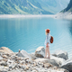 Traveler looks at the lake in Austria. Travel and tourism - PhotoDune Item for Sale
