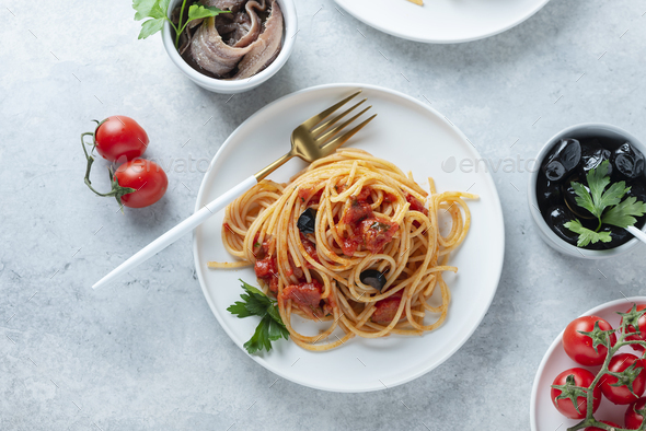 Traditional italian pasta puttanesca - Stock Photo - Images