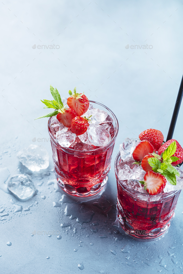 Red cocktail with ice and mint - Stock Photo - Images