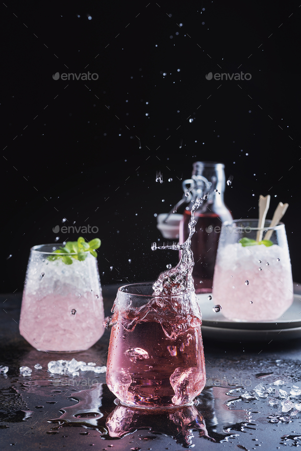 Splash of a pink cocktail - Stock Photo - Images