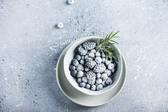 Frozen berry and rosemary - Stock Photo - Images