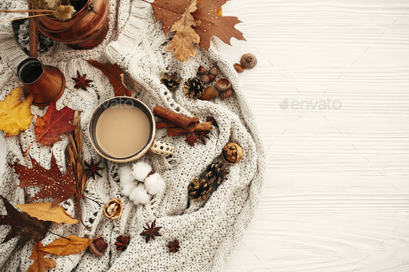 Autumn flat lay, cozy inspirational image.Hygge lifestyle. Coffee cup with  fall leaves - Stock Photo - Images