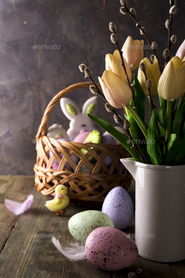 spring tulips with easter eggs on rustic background - Stock Photo - Images