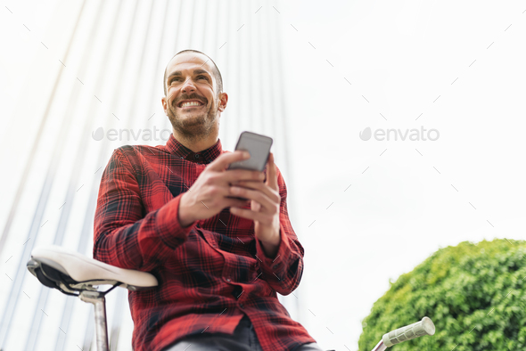 Young man with mobile phone and fixed gear bicycle. - Stock Photo - Images