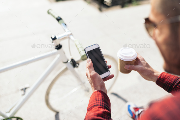Young man using his mobile in the street. - Stock Photo - Images