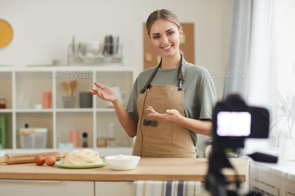 Woman teaching to cook online - Stock Photo - Images