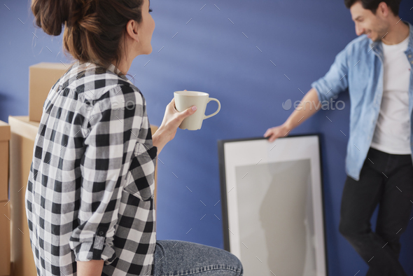 Couple having a break during moving a house - Stock Photo - Images