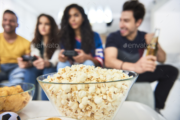 Detail of popcorn during playing on the console - Stock Photo - Images