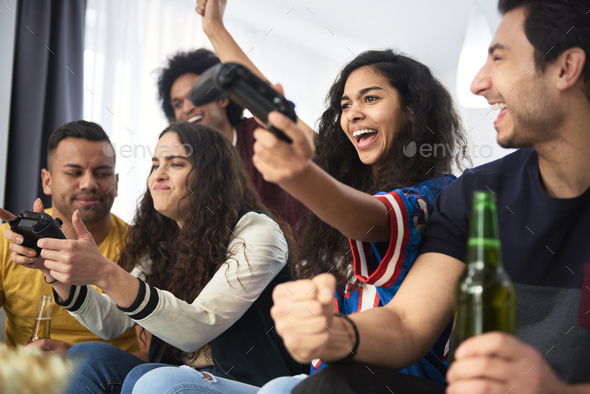 Girl wining during competition on the console - Stock Photo - Images