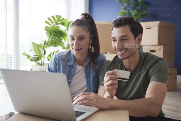 Couple doing shopping online for a new house - Stock Photo - Images