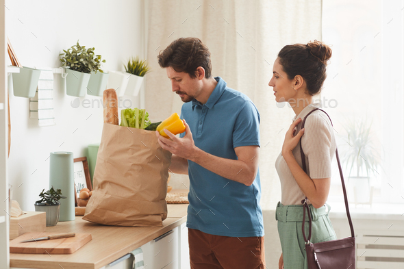 Couple buying products to home - Stock Photo - Images