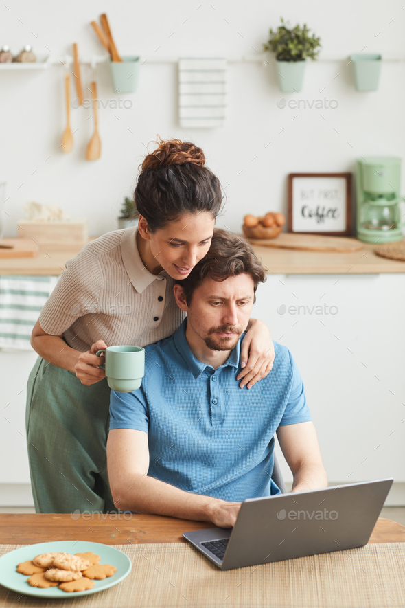 Young man working at home - Stock Photo - Images