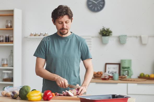 Man preparing dinner - Stock Photo - Images