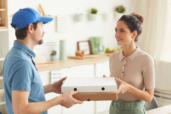 Man delivering pizza - Stock Photo - Images