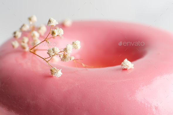 Close up view glazed surface of homemade souffle from strawberry fruits with plant twig for - Stock Photo - Images