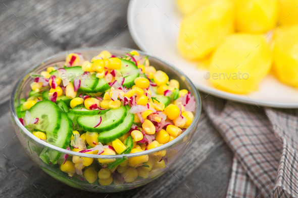 salad with rucola couscous and nuts avocado, green vegetarian healthy diet food - Stock Photo - Images