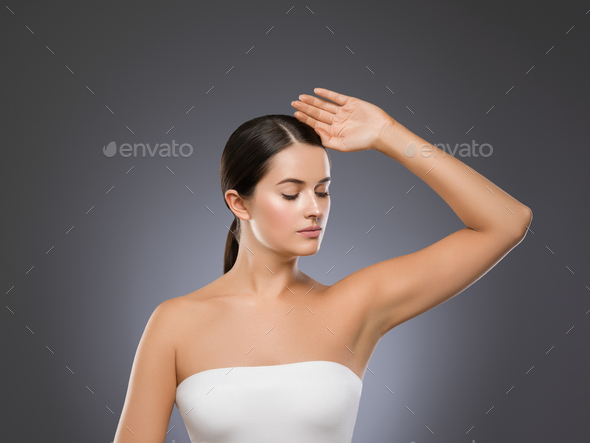 Clean skin beauty woman face healthy skin natural make up tanned female over blue background - Stock Photo - Images