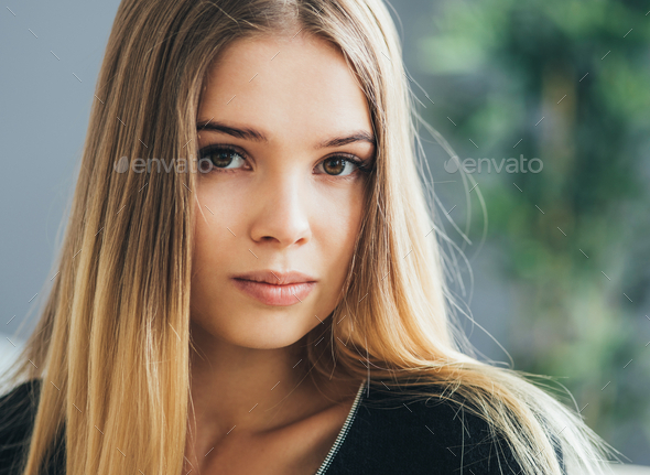 Woman natural indoor portrait, blonde long hair cute face - Stock Photo - Images