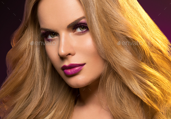 Beautiful woman face makeup colorful violet purple blonde long hair beauty concept - Stock Photo - Images