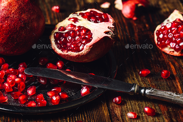 Opened Pomegranate with Seeds - Stock Photo - Images