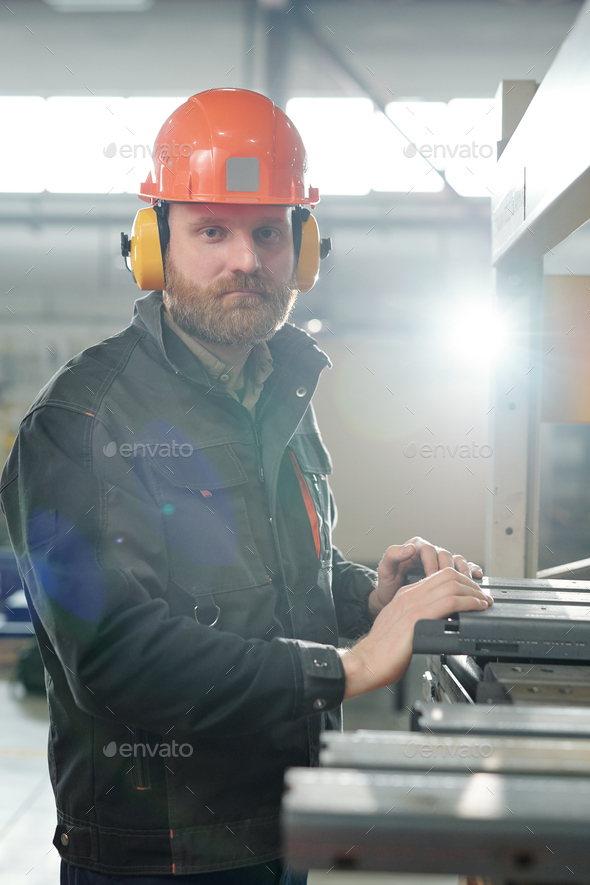 Man working with metal pieces - Stock Photo - Images