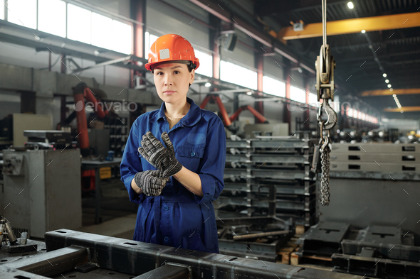 Woman in metalworking industry - Stock Photo - Images