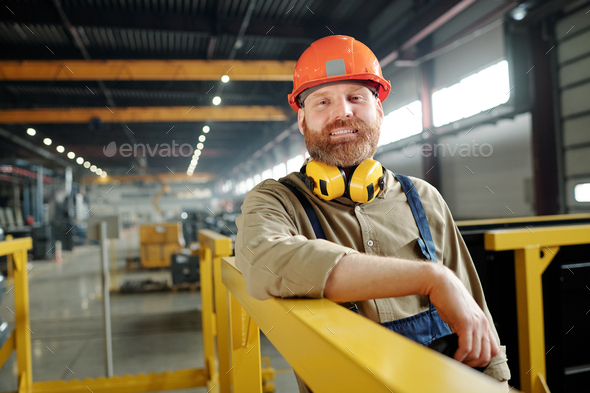 Positive male worker in hardhat - Stock Photo - Images