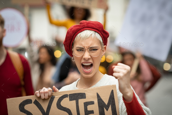 Angry woman in protest march for her rights - Stock Photo - Images