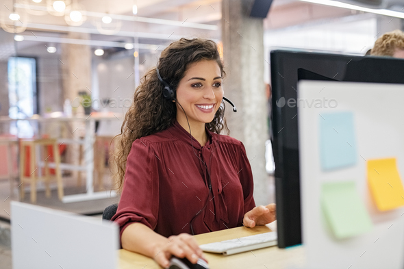 Happy smiling woman working in call center - Stock Photo - Images
