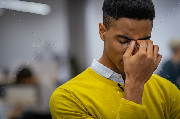 Stressed young man with migraine - Stock Photo - Images