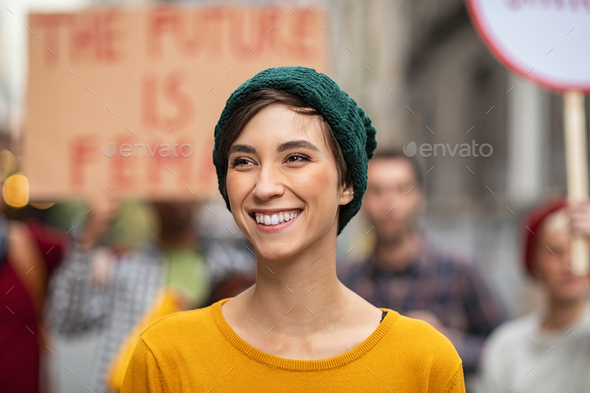 Happy smiling woman in protest for female rights - Stock Photo - Images
