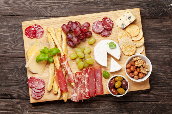 Cheese, meat, grapes and olives antipasto - Stock Photo - Images