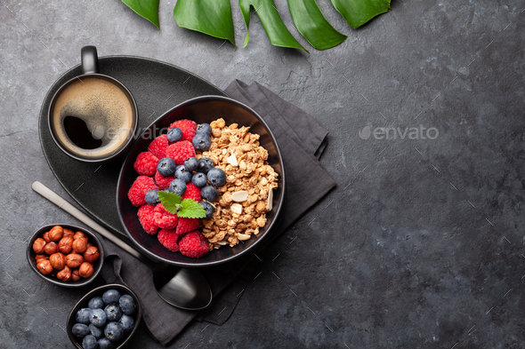 Healthy breakfast with granola, nuts and berries - Stock Photo - Images