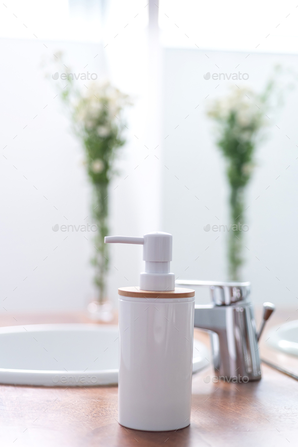 Soap dispenser in a modern bright bathroom - Stock Photo - Images