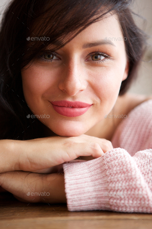 smiling white woman leaning on table at home - Stock Photo - Images