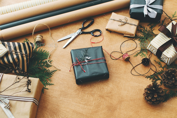 Stylish christmas gift box in black paper. Season's greetings - Stock Photo - Images