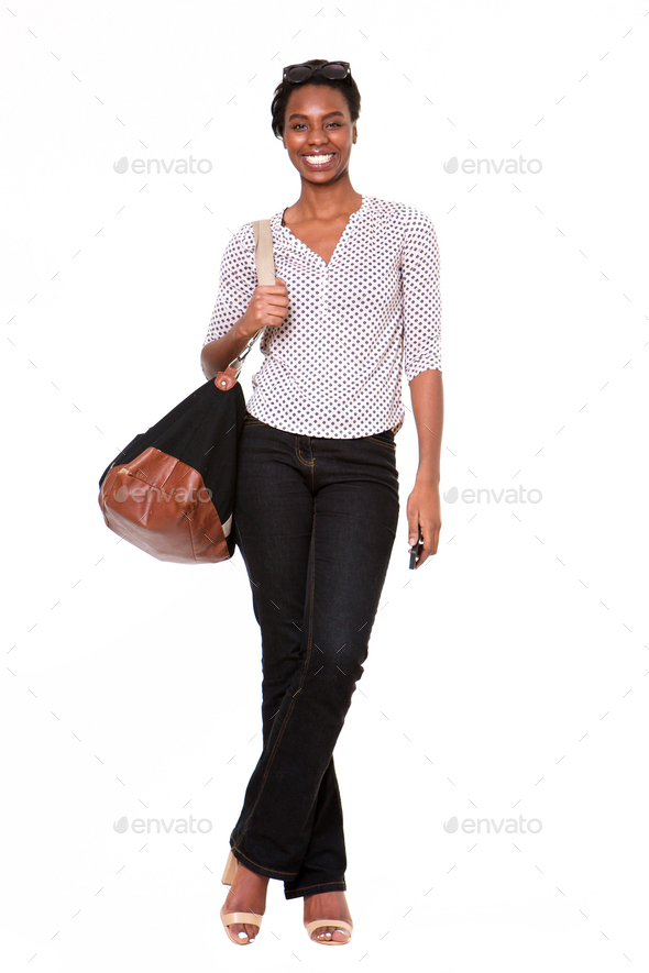 Full length beautiful african american woman with purse and mobile phone - Stock Photo - Images