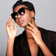 Close up beautiful black woman in sunglasses with hands to face - PhotoDune Item for Sale
