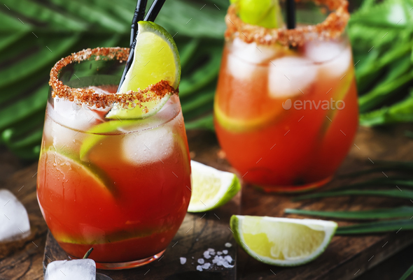 bloody mary alcoholic cocktail with beer, lime juice, tomato juice, spicy sauce and spices - Stock Photo - Images
