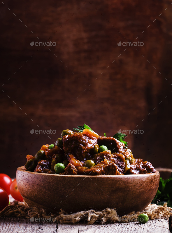 Ragout with beef, carrots, green peas and tomatoes - Stock Photo - Images