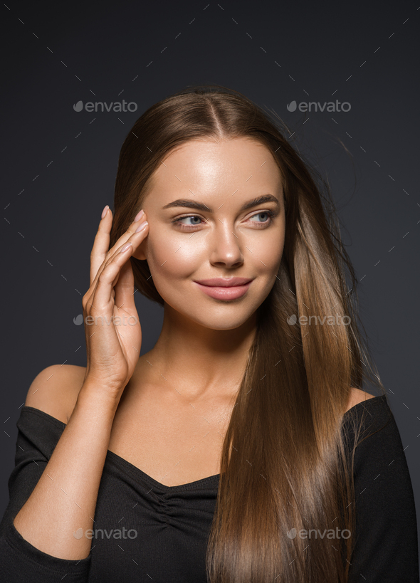 Smooth beauty woman long hair brunette female model natural makeup beautiful girl dark background - Stock Photo - Images