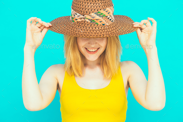 Beautiful emotional woman with hat. Blue color background. - Stock Photo - Images
