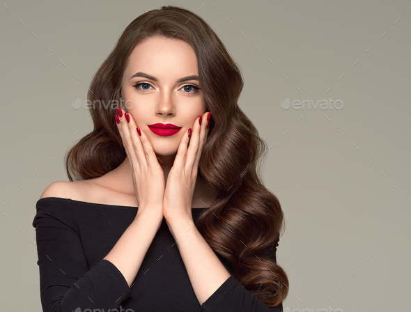 Red lipstick woman beauty hair close up face fashion portrait manicured hands - Stock Photo - Images