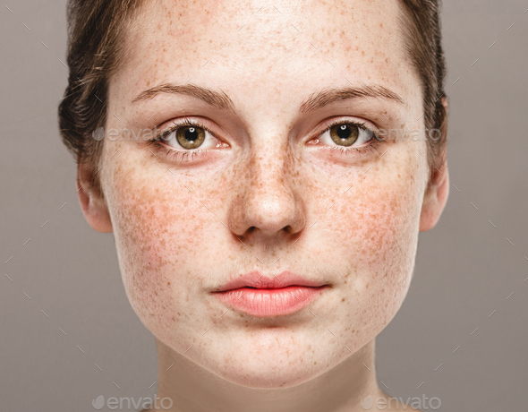 Young beautiful freckles woman face portrait with healthy skin - Stock Photo - Images