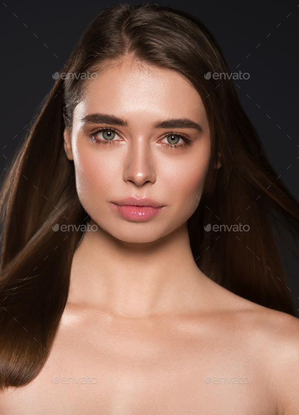 Woman beauty natural make up healthy skin and hair dark background - Stock Photo - Images