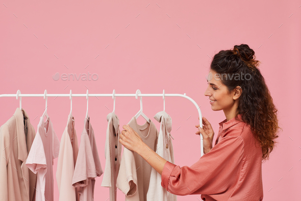 Woman choosing clothes - Stock Photo - Images