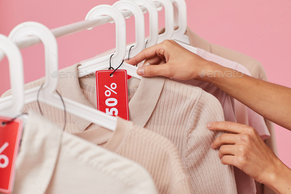 Woman buying clothes on sale - Stock Photo - Images
